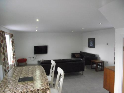 A seating area at 6B Church St. Dingwall Apartment