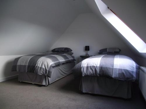 A bed or beds in a room at 6B Church St. Dingwall Apartment