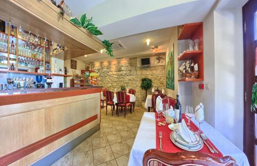 A restaurant or other place to eat at Hotel Trogir