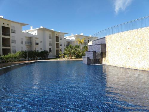 The swimming pool at or near Encosta Da Orada Vista Mar