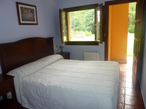 Cama o camas de una habitación en Hotel Apartamentos La Hortona