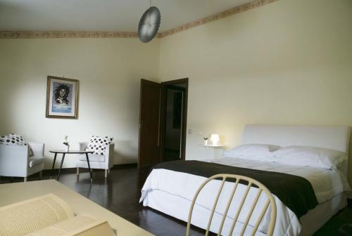 Letto o letti in una camera di Liodoro Catania B&B