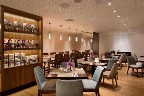 A restaurant or other place to eat at Isrotel Tower Hotel