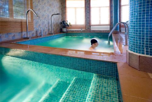 The swimming pool at or near Hotel Balneario Almeida Dama Verde