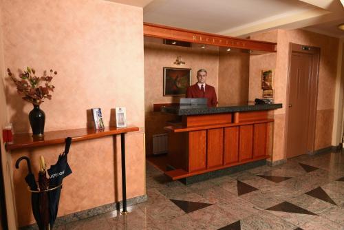 Лобби или стойка регистрации в Hotel Glam
