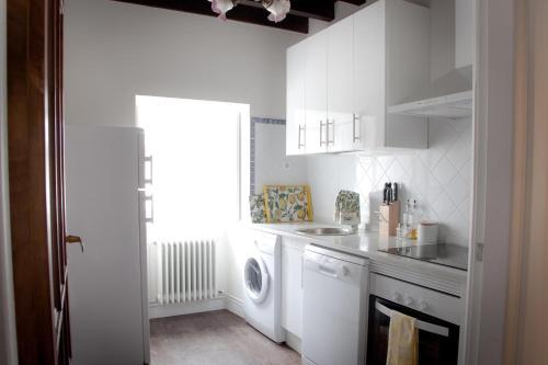 A kitchen or kitchenette at Casona Puerto de Vega