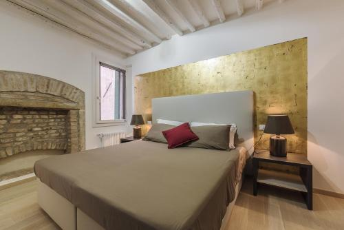 Cama ou camas em um quarto em Cà Del Tentor