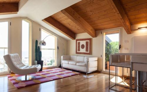 A seating area at Appartamento Regina Margherita 171