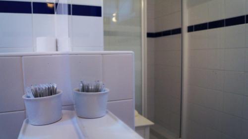 Salle de bains dans l'établissement Hotel du Saumon