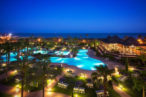 A view of the pool at Puerto Antilla Grand Hotel or nearby