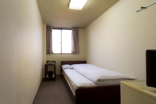 ビジネスホテル和香にあるベッド