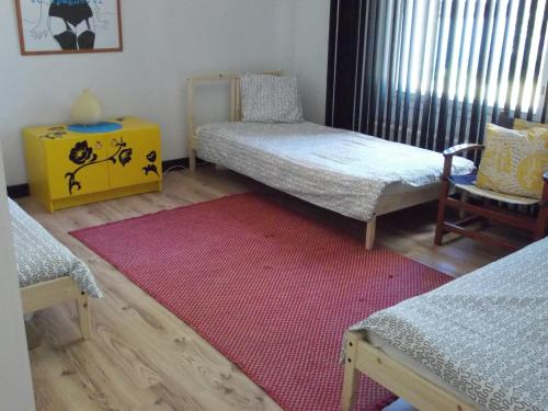 A bed or beds in a room at Warkhaus Apartments