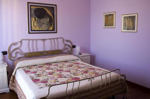 A bed or beds in a room at Casa Lilla