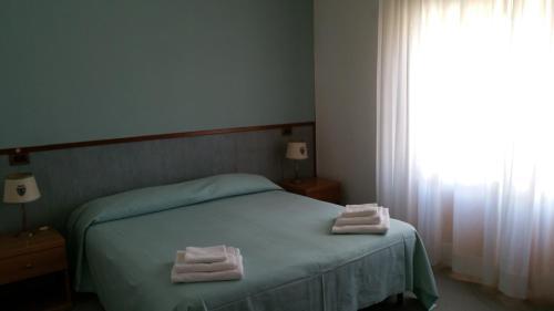 Cama o camas de una habitación en Hotel Redi