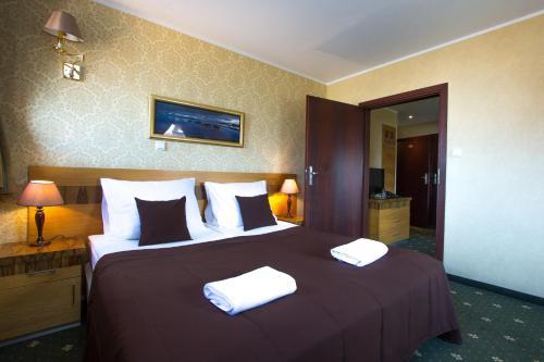 Łóżko lub łóżka w pokoju w obiekcie Hotel Królewski