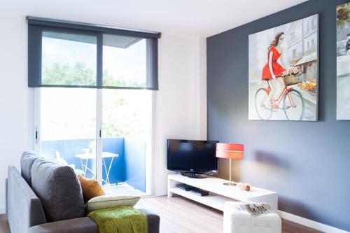 A television and/or entertainment center at Feelathome Poblenou Beach Apartments
