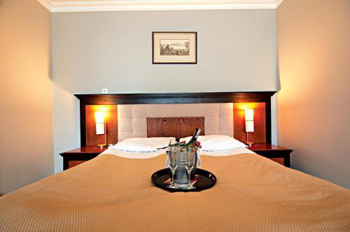 Łóżko lub łóżka w pokoju w obiekcie Łeba Hotel & Spa