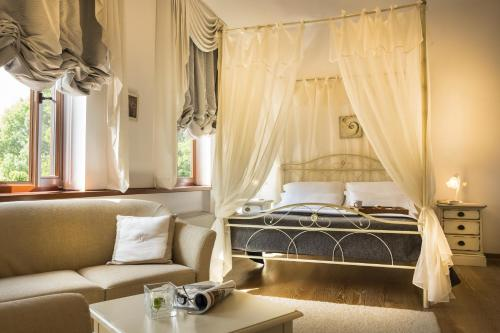 A bed or beds in a room at B&B Palazzo Angelica Adults Only