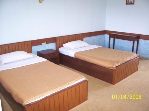 เตียงในห้องที่ สายชลวิว ริเวอร์แคว รีสอร์ท