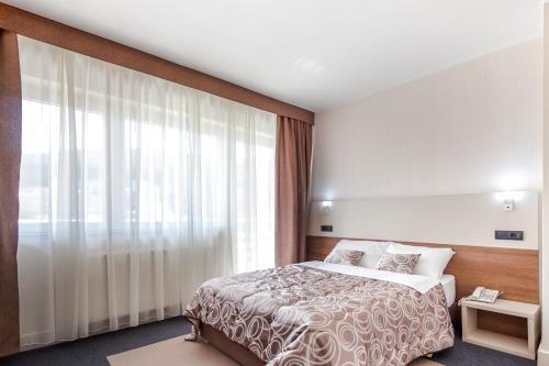 Postel nebo postele na pokoji v ubytování Hotel Macola