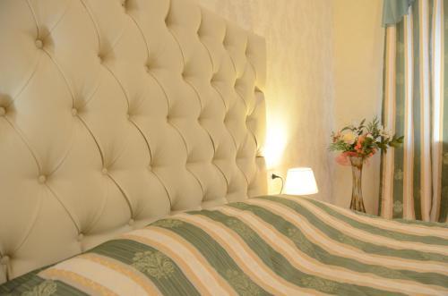 Кровать или кровати в номере Бизнес Отель Кострома