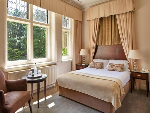 A bed or beds in a room at Macdonald Frimley Hall Hotel & Spa