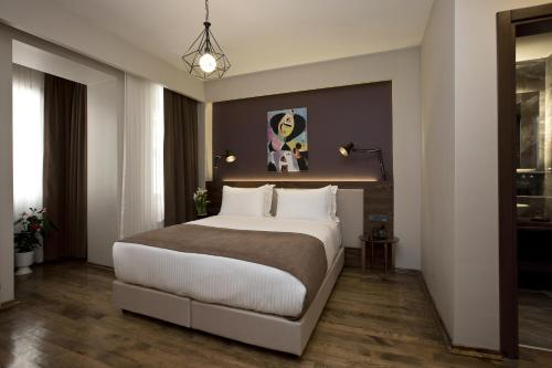 A bed or beds in a room at Snog Rooms & Suites