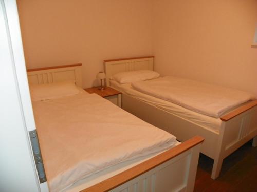Ein Bett oder Betten in einem Zimmer der Unterkunft Ferienwohnung Göttsche-Hof