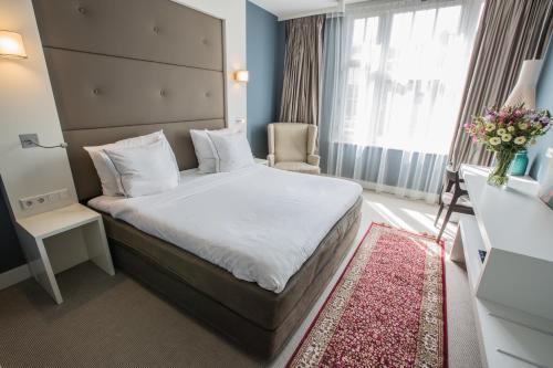Een bed of bedden in een kamer bij Hotel JL No76