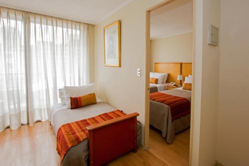 Cama ou camas em um quarto em Apart Hotel RQ City Center