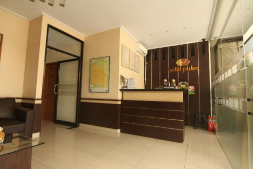 The lobby or reception area at Hotel Pules