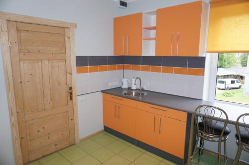 A kitchen or kitchenette at Holiday Apartment