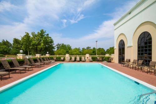 The swimming pool at or near Embassy Suites Greenville Golf Resort & Conference Center