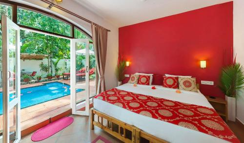 A bed or beds in a room at Marari Villas - Private Pool Villas