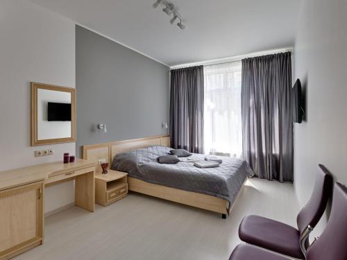 Кровать или кровати в номере Минима Водный Отель