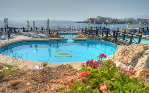 The swimming pool at or near Radisson Blu Resort, Malta St. Julian's