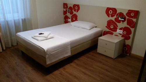 Ein Bett oder Betten in einem Zimmer der Unterkunft Ristorante Stazione con alloggio