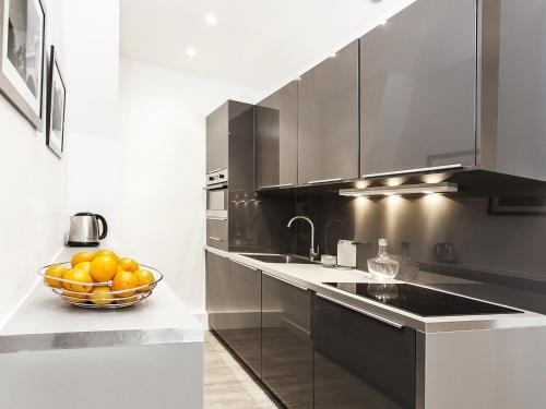 A kitchen or kitchenette at Luxury 2 Bedrooms Grands-Boulevards I by Livinparis