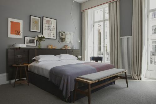A bed or beds in a room at The Laslett