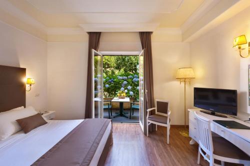 TV o dispositivi per l'intrattenimento presso Grand Hotel Parco del Sole - All Inclusive