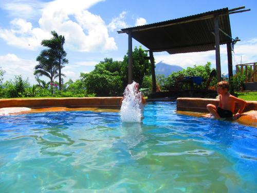 The swimming pool at or near Essence Arenal and Spa
