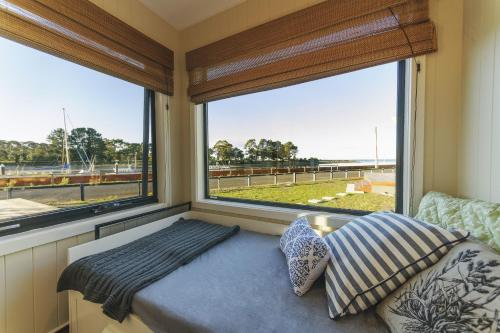 A bed or beds in a room at Coastal Pods Wynyard