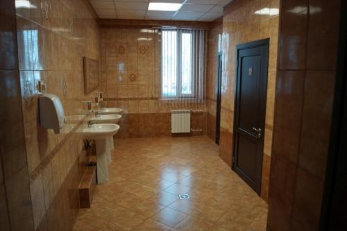 Ванная комната в Hotel Kurilotransavto