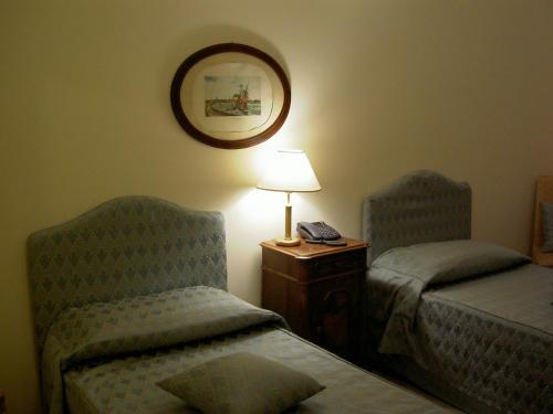 Letto o letti in una camera di Relais Villa Rossi