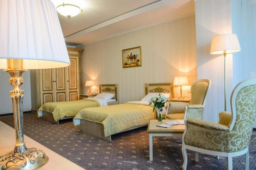 A bed or beds in a room at SK Royal Hotel Moscow