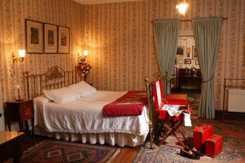 Cama o camas de una habitación en Hotel Hacienda los Lingues