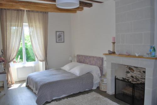 Un ou plusieurs lits dans un hébergement de l'établissement La Petite Boire - Maison d'hôtes - Bed & Breakfast