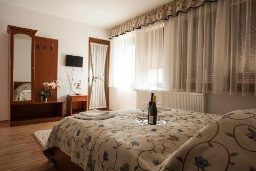 A bed or beds in a room at Wekler Családi Pincészet és Panzió