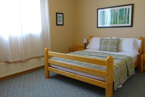 A bed or beds in a room at Aurora Inn