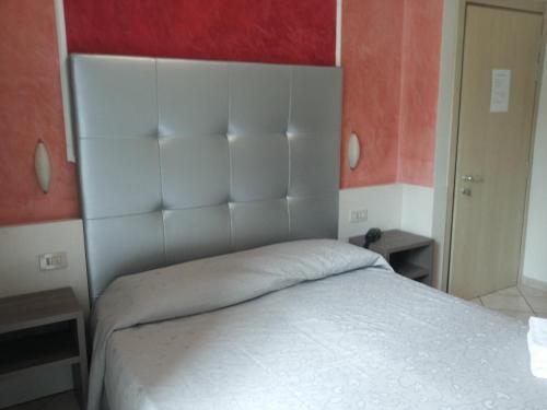 Кровать или кровати в номере Hotel Le Querce